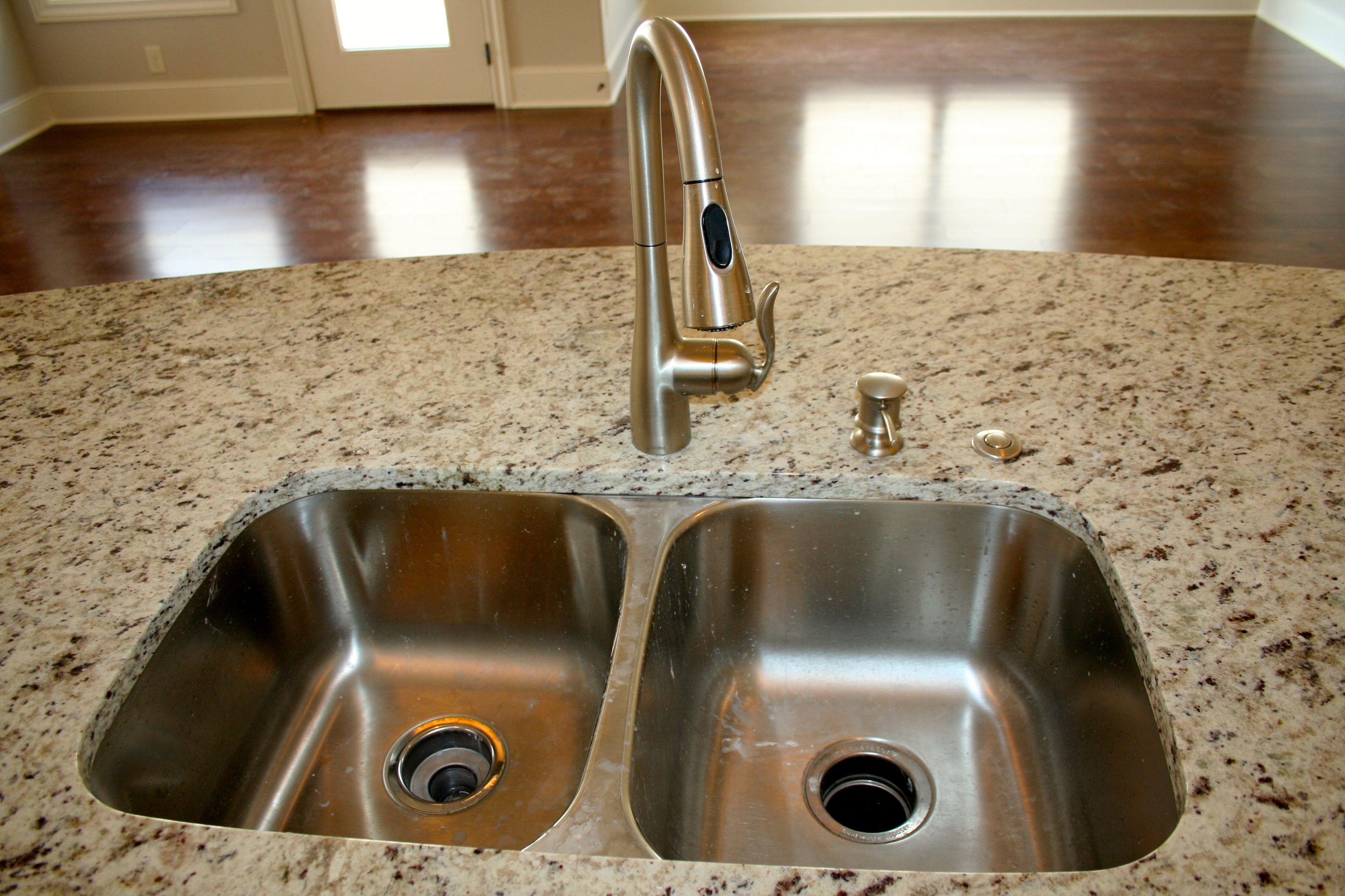 SINK: Standard 50/50 Stainless. FAUCET: Upgrade   Moen Arbor Stainless Steel