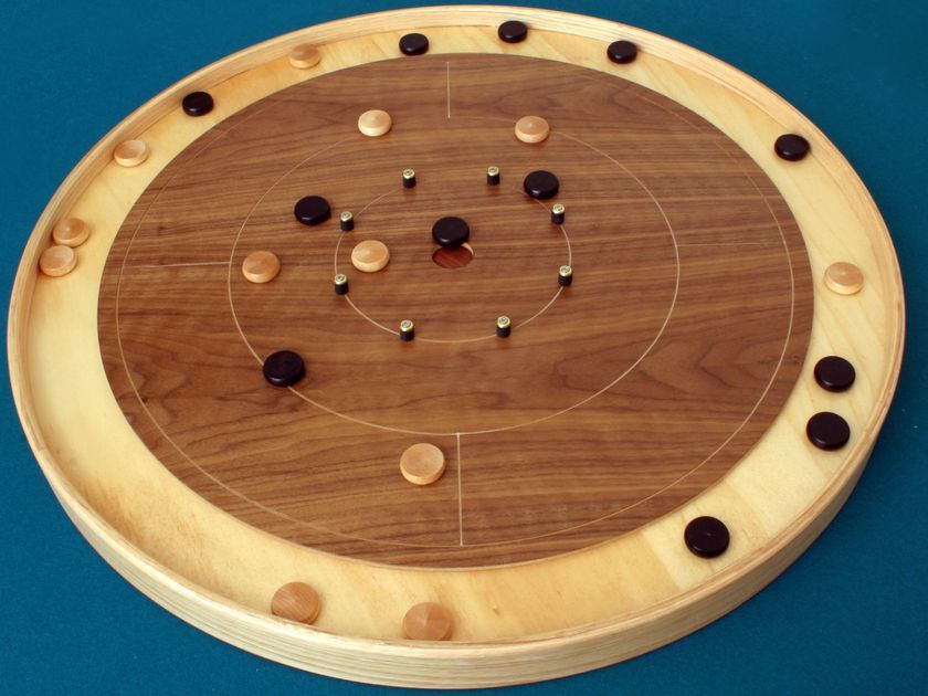 This game is like shuffleboard in the round. Players take