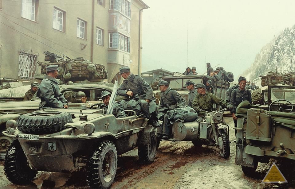 A Surrendered Schwimmwagen Kfz1 Type 166 (WH 1641890) and a BMW 75 Motor bike & side car with other vehicles of the 278. Infanterie Division (Wehrmacht) at the Brenner Pass, on the Italian - Austrian Border. May 1945.