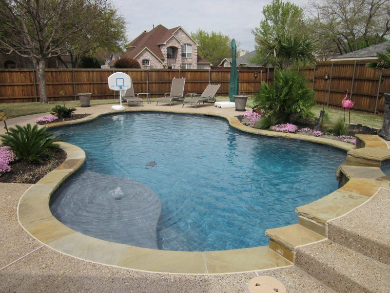 Freeform Natural Pool Flagstone Coping Tanning Ledge With Bubbler Washed Aggregate Decking