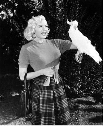 Jayne Mansfield with a cockatoo.