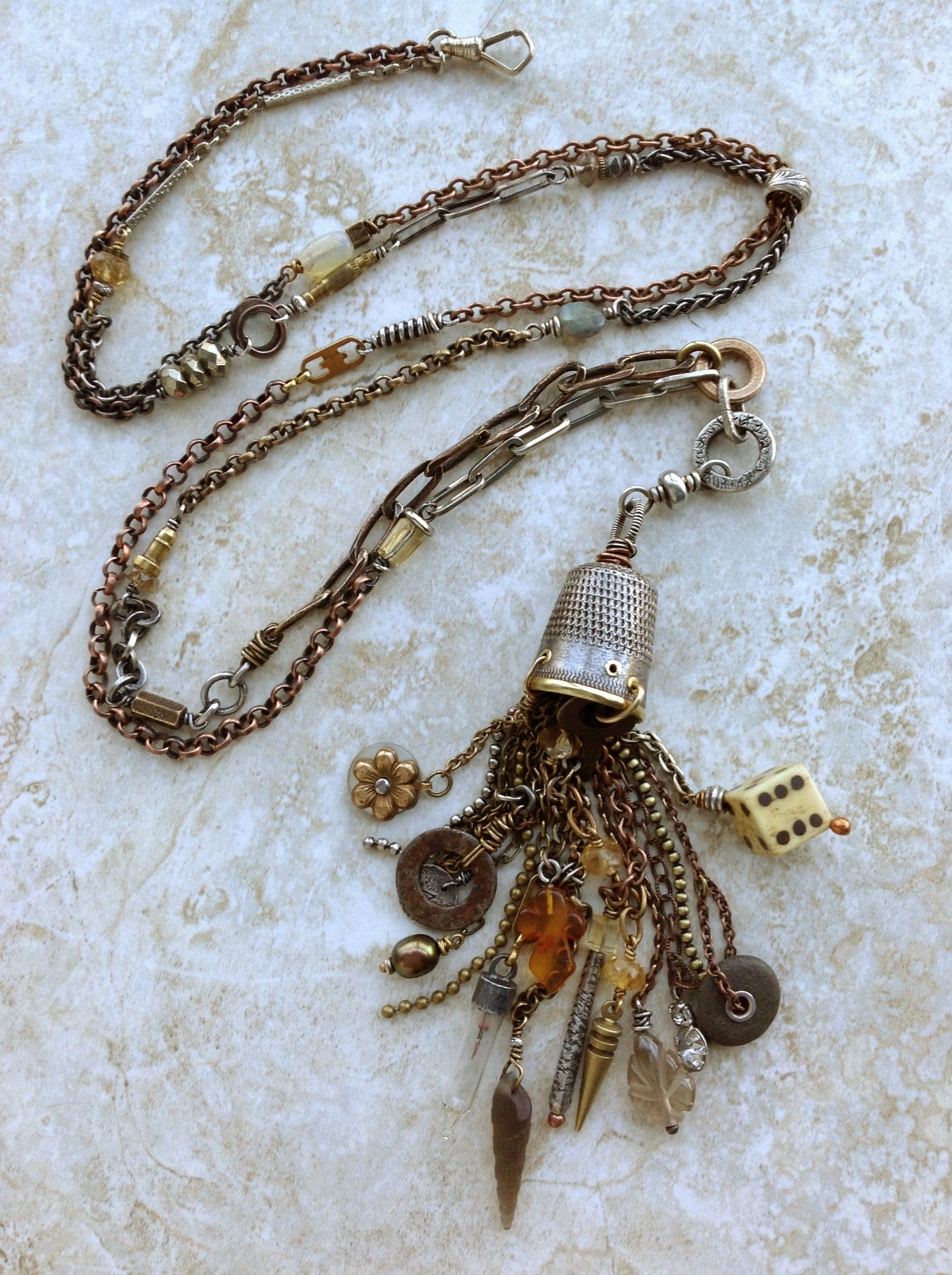 Thimble tassel with found object charms, on a collage chain.
