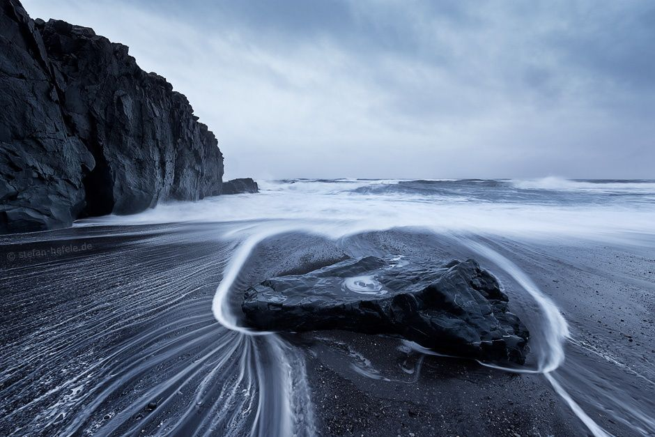 """Lava Beach - """"Lava Beach"""" - Eastcoast - Iceland  Even with dim and grey light it´s possible to get atmospheric landscape shots. In this kind of artistic-arrangement shapes and structures are most important. It´s not the kind of """"feeding the masses""""-photography but more an interesting visual art. Sometimes it´s hard to realize the wild sea in this wide angle shots, but If I had not taken my legs in my hand here, I would have been soaked to the skin... :-)  Prints and licensing available..."""