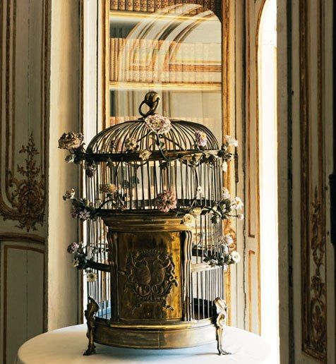 """charming - poetic wanderlust- This copper cage adorned with porcelain flowers was home to Madame du Barry's pet parrot. The bird was trained to say """"La voilà la belle comtesse!"""" (There goes the lovely lady!) whenever she appeared."""