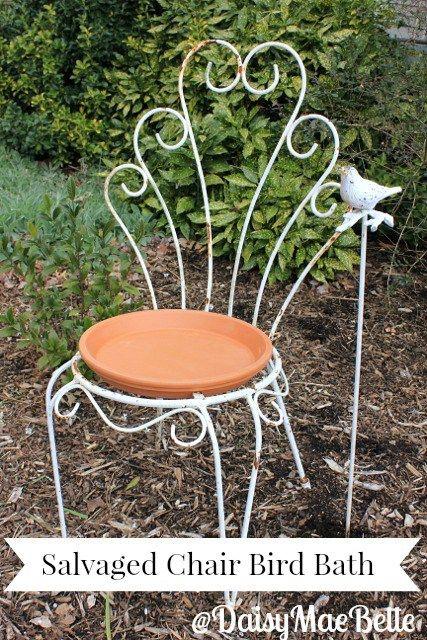 Vintage iron garden patio chair and terracotta flower pot bottom bird bath