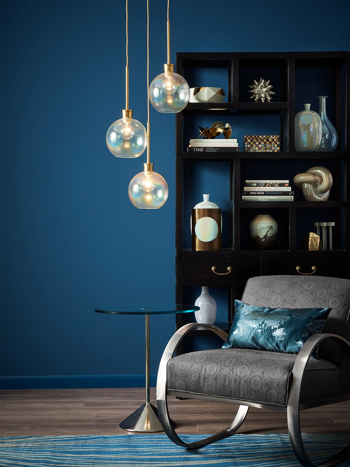 Corner Of A Room With Silver Grey Chair And Dark Blue Walls Blue Painted Walls Dark Blue Walls Dark Blue Rooms Silver blue paint living room