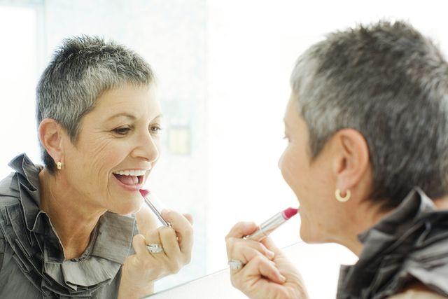 Must Read Makeup Tips for Women Over 50: older woman applying lipstick