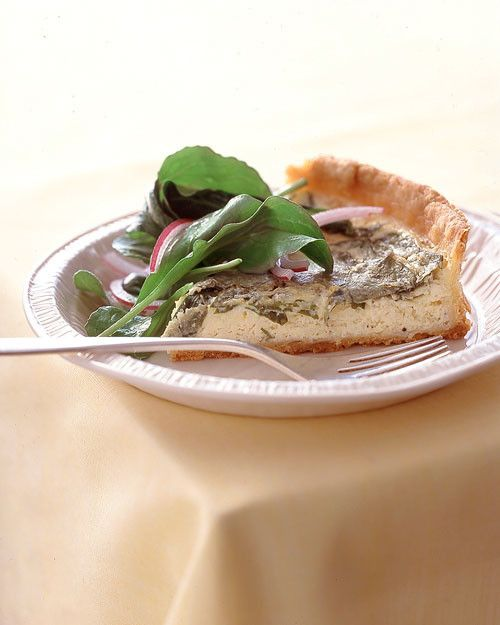 Add a salad, and quiche becomes a complete meal. This version gets richness from ricotta and bursts of flavor from peppery arugula and lemon zest.