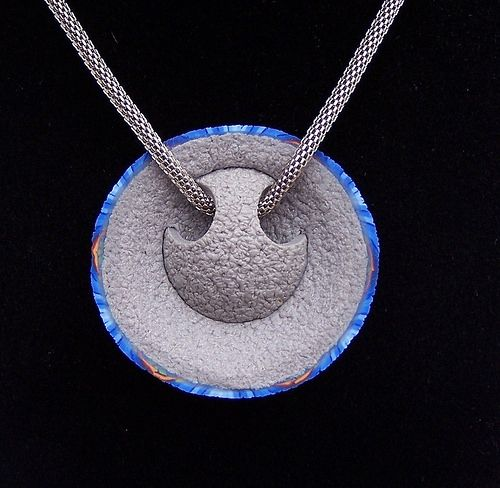 Jan Montarsi.  His original design for pendant back allowing for various size cording or chain to be strung through