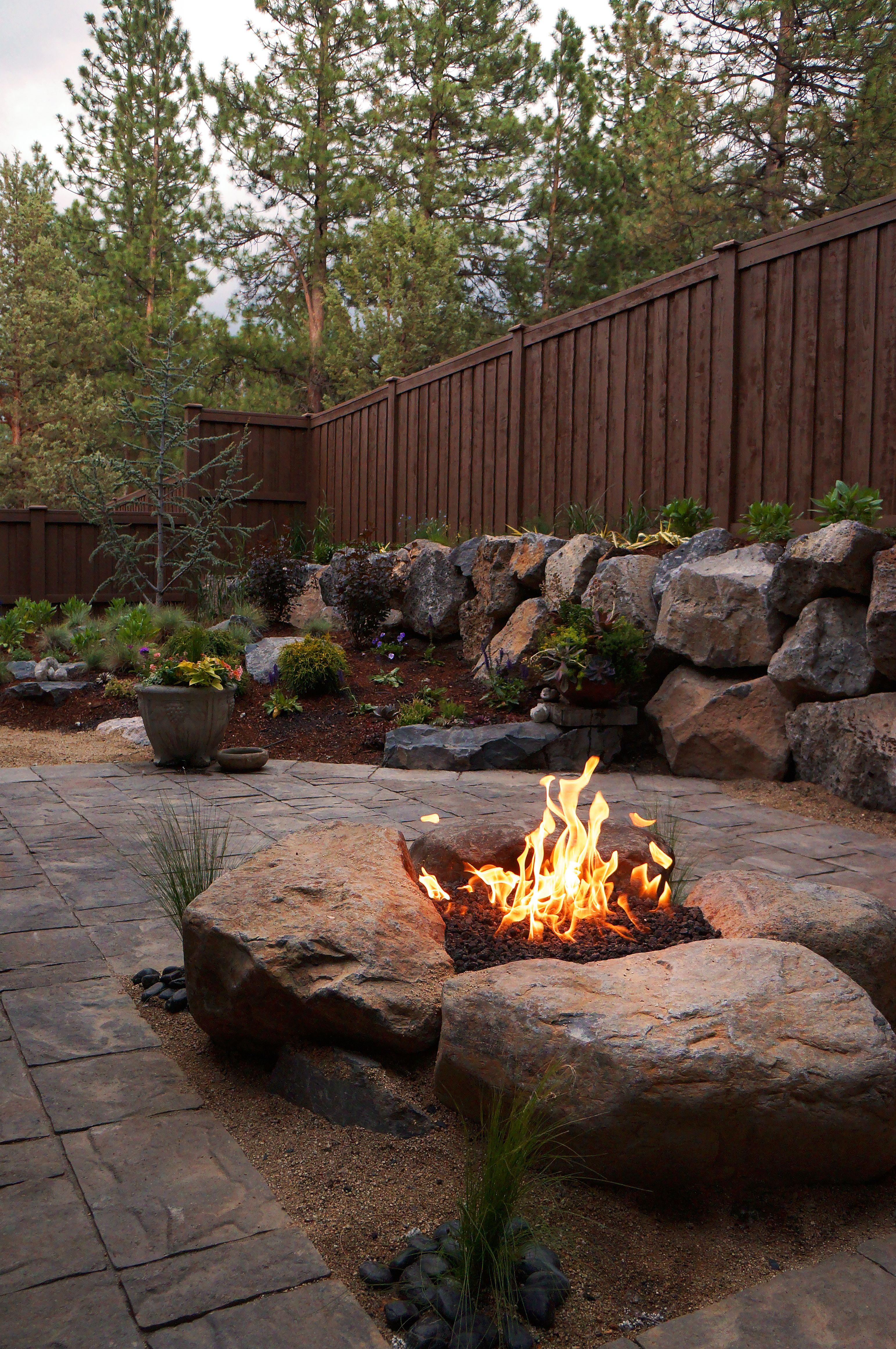 Paver patio with gas firepit love the big rocks firepit