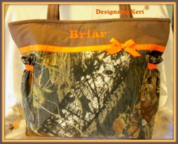 Hunters Mossy Oak camo Duffle Diaper bag pick ribbon color add a name to make special. $75.99, via Etsy.