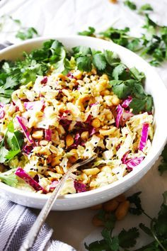 Crunchy Cabbage Salad with Peanut Dressing [21 Day Fix] - Healthy and loaded with flavor, this easy salad is tough to beat! Vegan, gluten free - http://TheGarlicDiaries.com