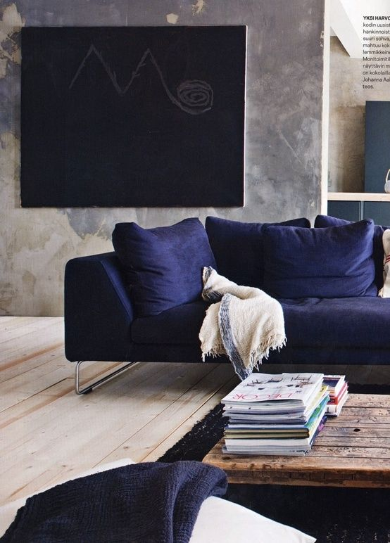 whatabout a blue couch with a big framed chalkboard above it...