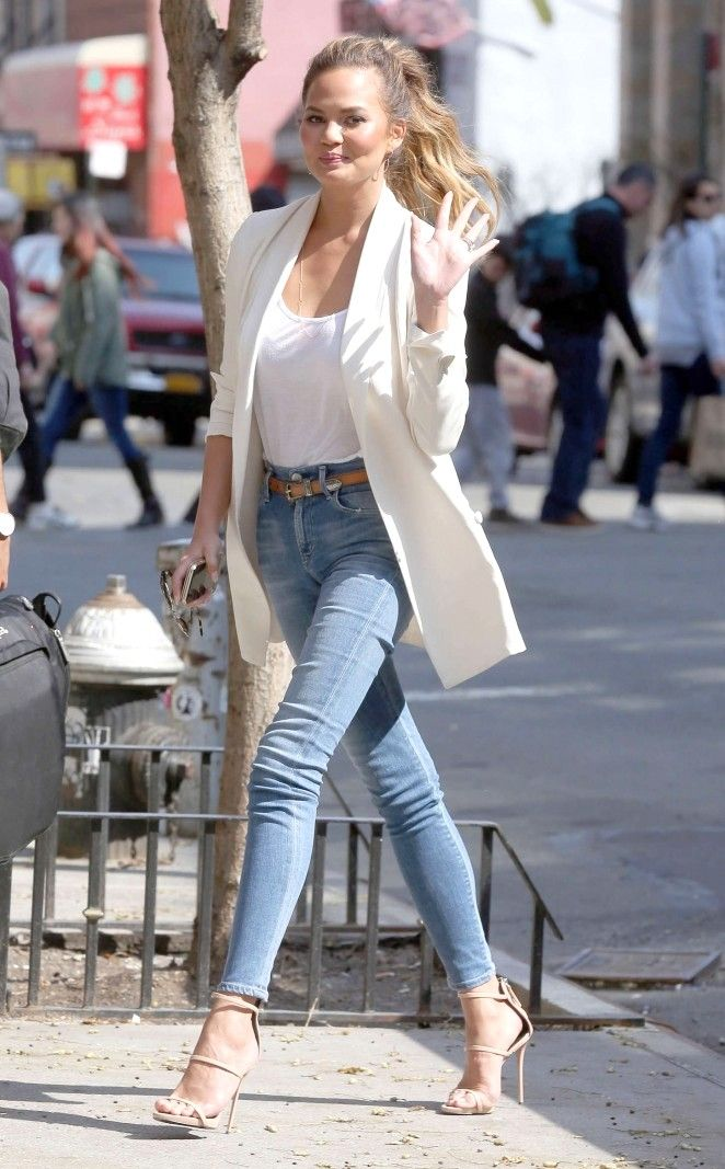 Chrissy Teigen in a cream blazer, white too and skinny jeans