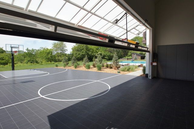 Outdoor basketball hoop home gym transitional with garage