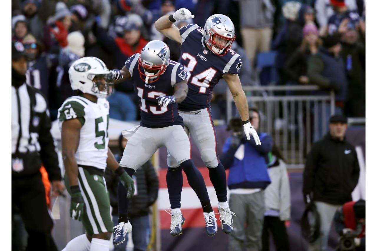 New England Patriots Running Back Rex Burkhead Right Celebrates His Touchdown Pass With Phillip Dorsett 13 During Patriots Nfl Football Games New York Jets
