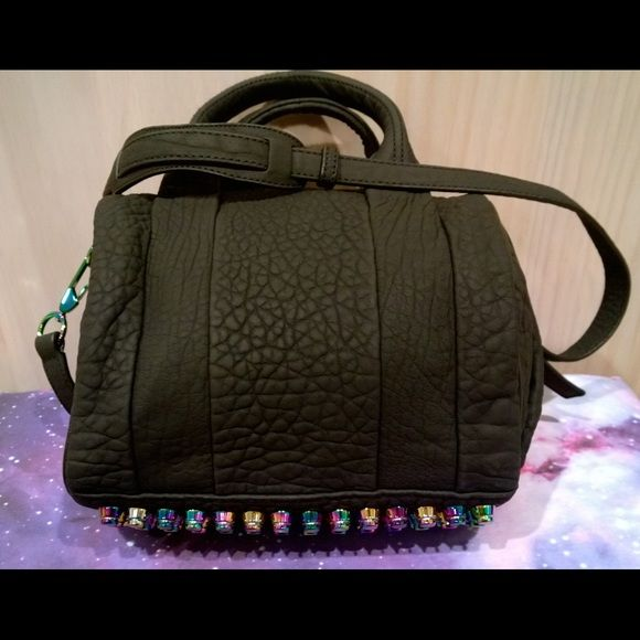 Alexander Wang Iridescent Stud Rockie Authentic Alexander Wang Iridescent stud Rockie. The leather is matte black and seriously perfectly pebbled. This Rockie still has tags attached and comes with dust bag as well as extra paperwork. Get it now while you can. Alexander Wang Bags Satchels