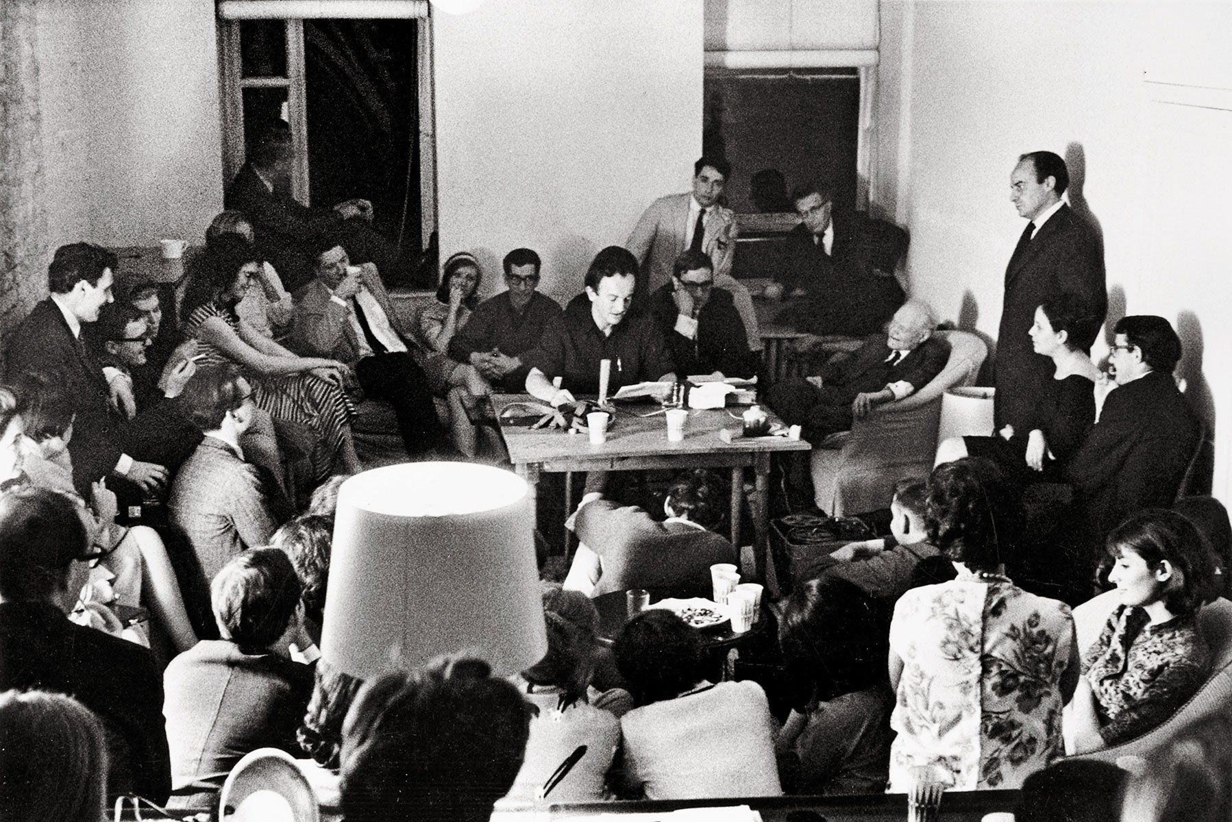 Frank O'Hara reads at the party given for Italian poet Giuseppe Ungaretti at the loft of Frank O'Hara and Joe LeSueur, New York City, May 1964.
