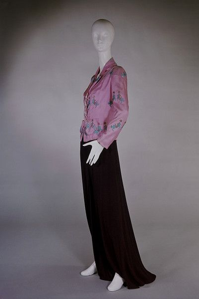 The Circus Collection Object: Evening ensemble Place of origin: Paris, France (made) Date: February 1938 (made) Artist/Maker: Schiaparelli, Elsa, born 1890 - died 1973 (designer) Materials and Techniques: Silk twill, fastened with cast metal buttons