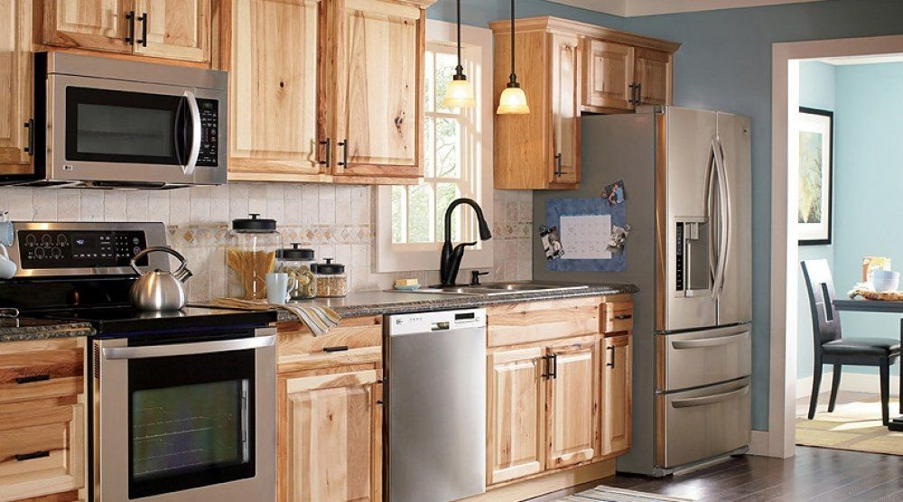 Assembled+hickory+kitchen+cabinets | These Light Hickory Kitchen Cabinets  Look Great With Black Countertops .