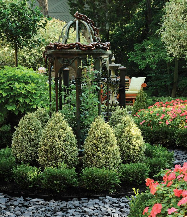 Passion blooms in a garden design english gardens water for English landscape design