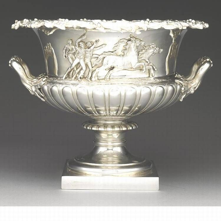 AN EDWARDIAN SILVER HORSE RACE TROPHY, ELKINGTON & CO, LONDON, 1909 of shallow campana form, partly fluted, applied on one side with youths chasing horses, the other with a vacant laurel wreath, the rim applied with a laurel garland, gilt interior