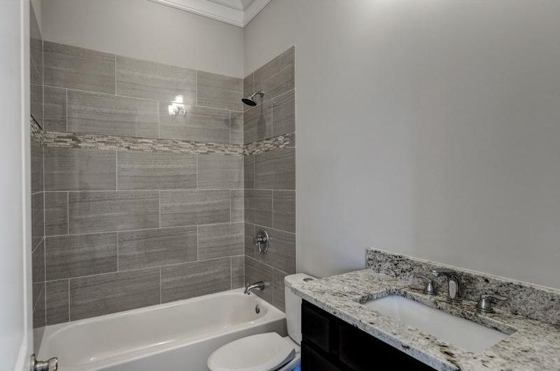 Contemporary Full Bathroom with Crown molding, Undermount sink, High ceiling, Raised panel, tiled wall showerbath