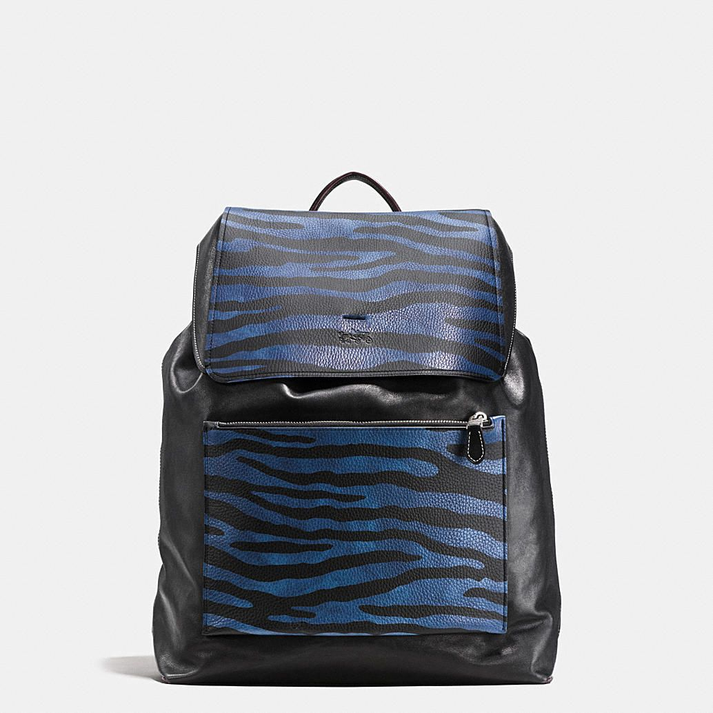 7890e674eb59 This spacious Coach backpack combines the ruggedness of pebble ...