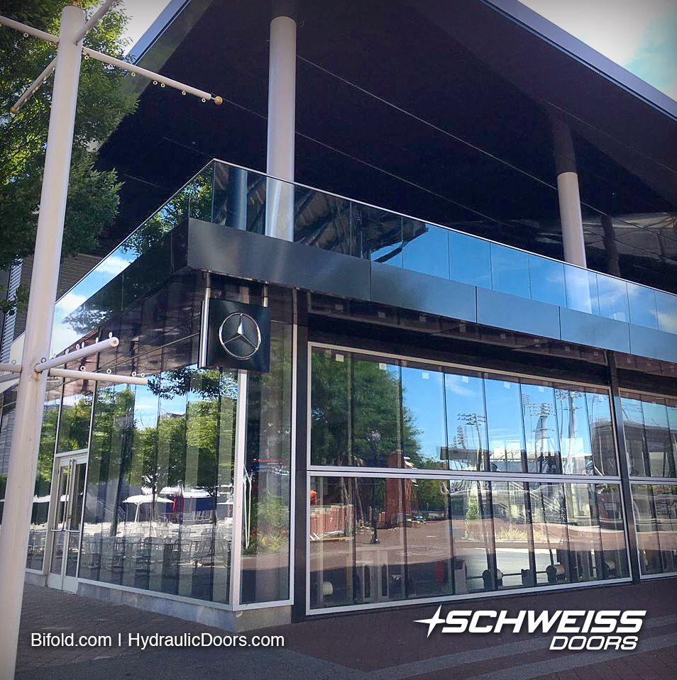Pin By Schweiss Doors On Glass Doors For The Us Tennis Assoc Building Building Architecture Glass Door