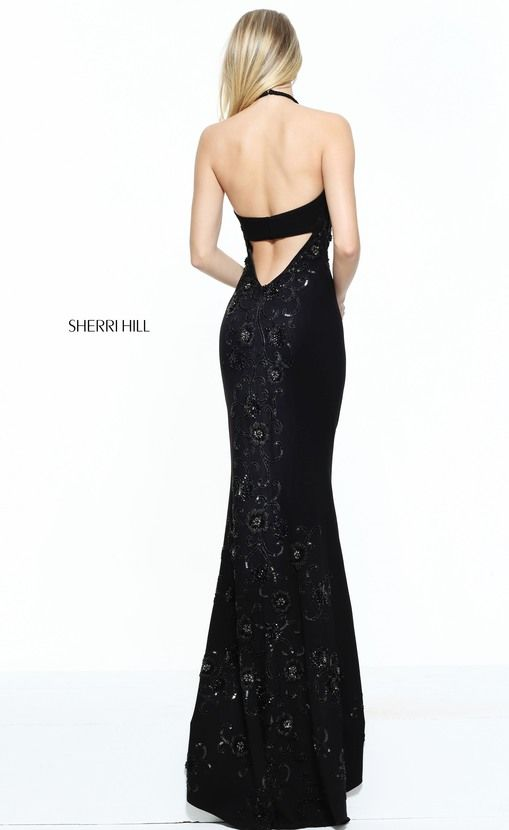 Get ready to party in this sultry evening gown from Sherri Hill The  flattering bodice has a chic halter neckline and shimmers with twinkling  tonal jeweled