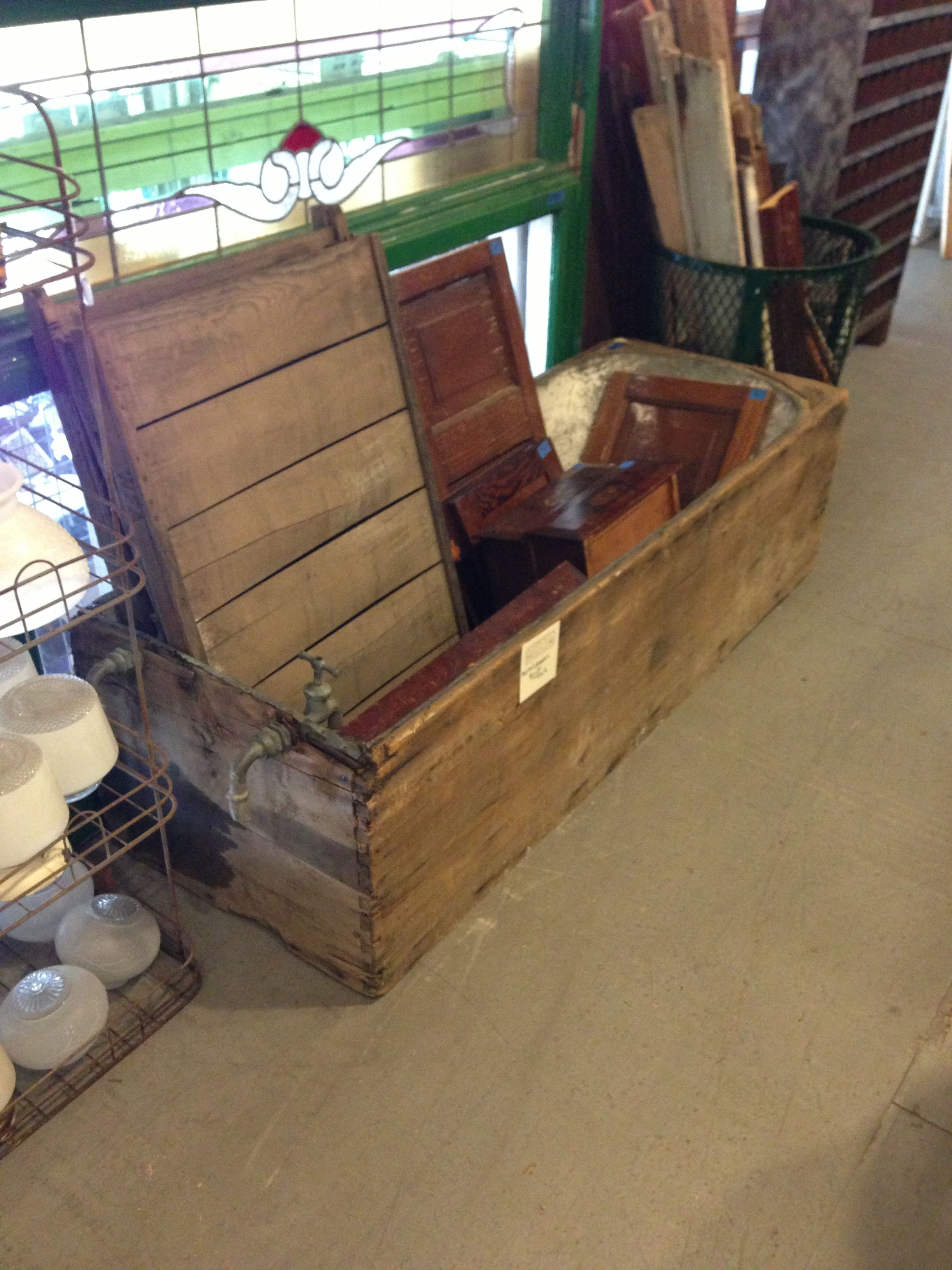 Antique bathtub for coffee table with interior lighting and