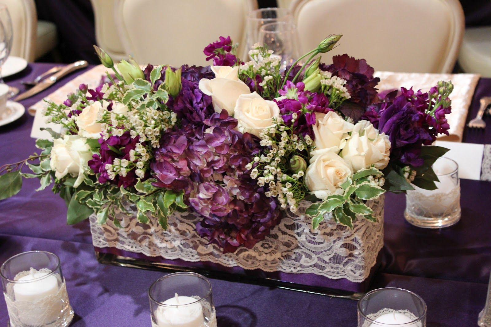 Round Wedding Table Flowers Eggplant Tall Arrangements With Calla Lily S Green Hanging Amaranthus