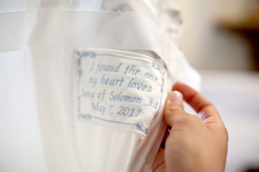 SO doing this for my wedding. Love quote sewn inside dress w/ date.