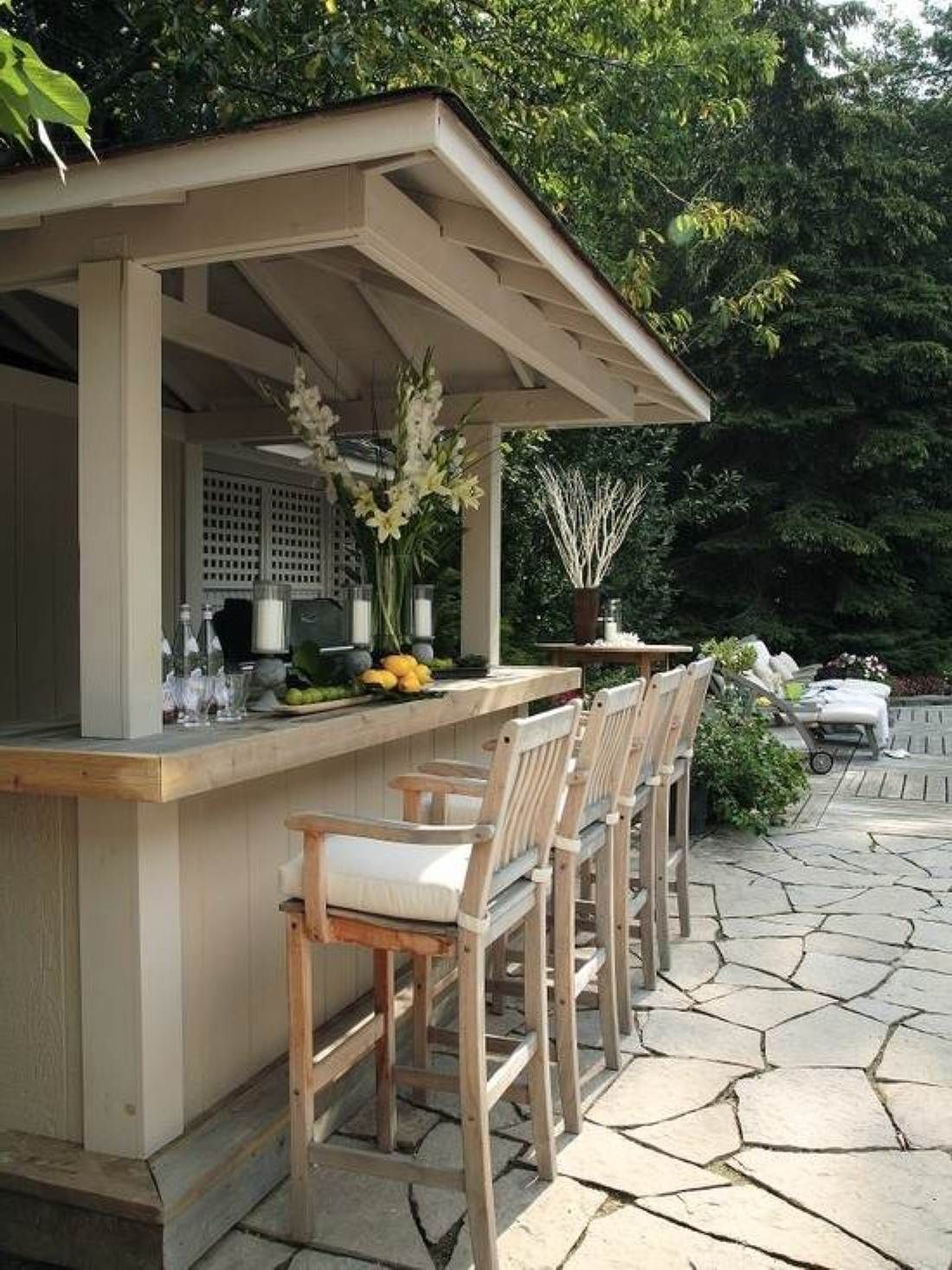 one of the highlights of this backyard is the natural cedar cabana