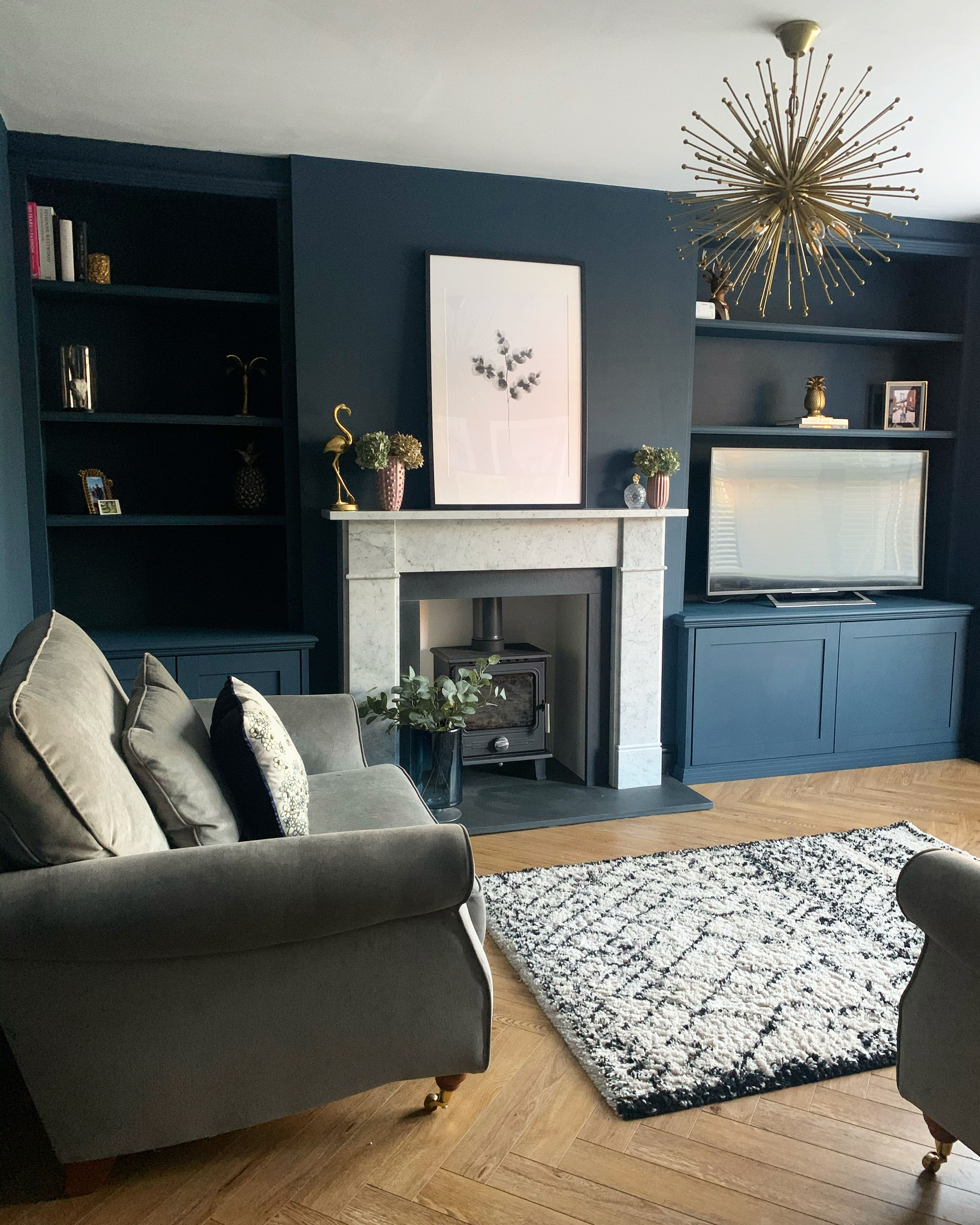 dark blue living room with marble fire surround