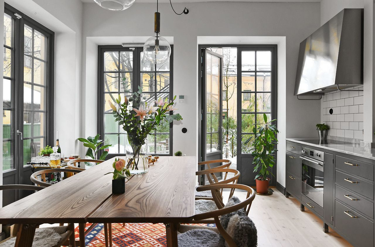 P Sophisticated Grey Kitchen And Dining Room With Wishbone Chairs