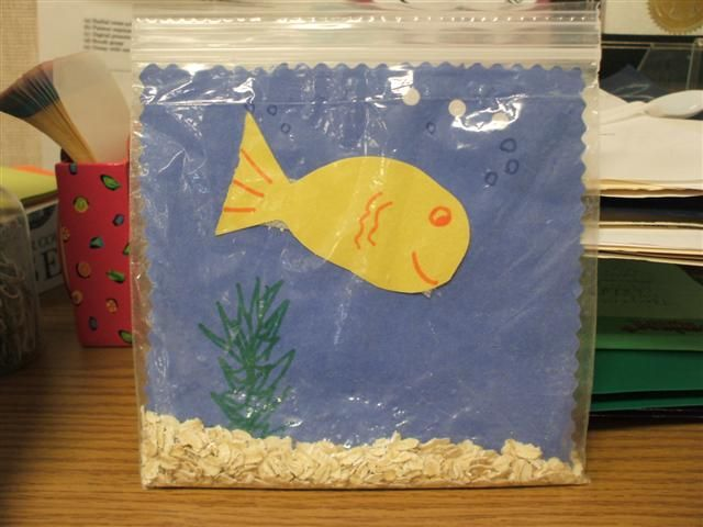 """Your Very Own Fish Tank activity - This activity develops pre-writing skills (drawing a face), imitation skills (copying from a model), fine motor skills (cutting and pincer grasp) as well as hand strength and control. Children are motivated to complete this activity and will be pleased that they have their own """"pet""""."""