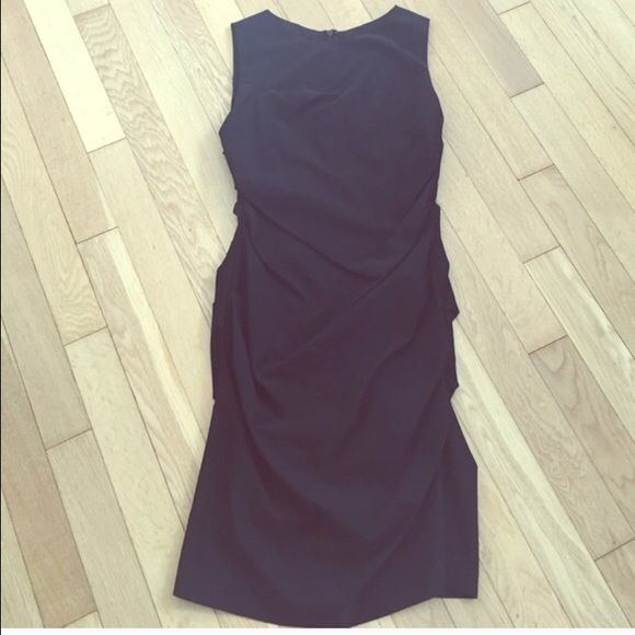 Nicole Miller dress A re-posh, this dress runs small, and that's why Im selling. Tag is a 10, fits like a 8. In excellent condition, it was listed as worn once when I purchased, i dry cleaned as well, but never wore it. Nicole Miller Dresses Midi