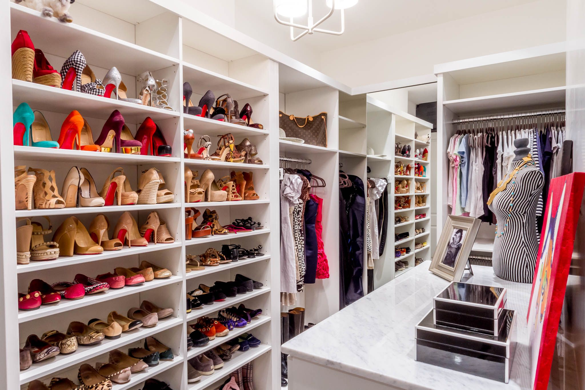 Different sized shoe shelves adorn this white