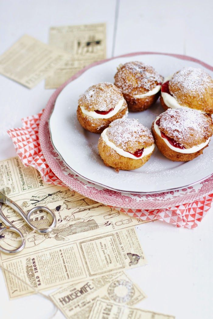 shrove buns with whipped cream and strawberry jam