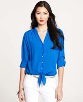 Tie Front Rolled Sleeve Blouse - Crafted from an airy featherweight fabric, this button down flaunts a chic tie front, a perfect match for slim fit pants and shorts. V-neck with mandarin collar. Long rolled sleeves with button tabs. Shirred drop shoulders. Tie front.