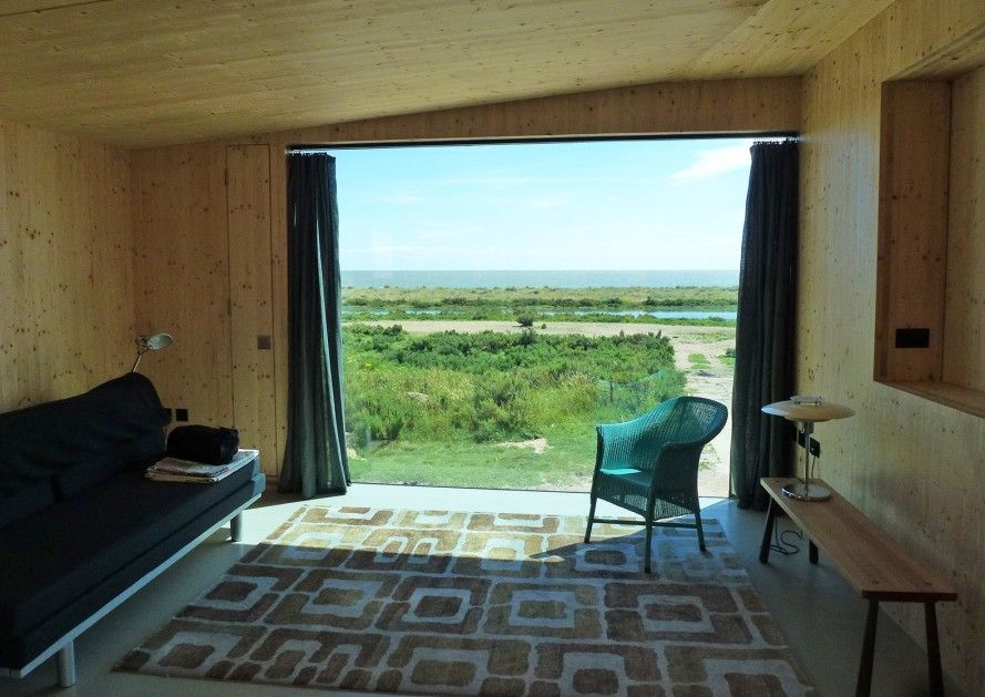 a tiny beach shack in essex wrapped in magic cork panels