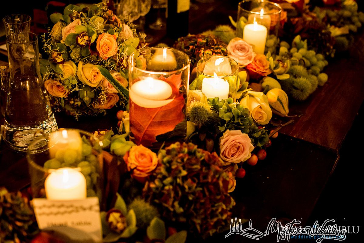 Fall wedding featuring wine tinged grape leaves, pomegranates, hydrangea and roses- Rustic Romance!