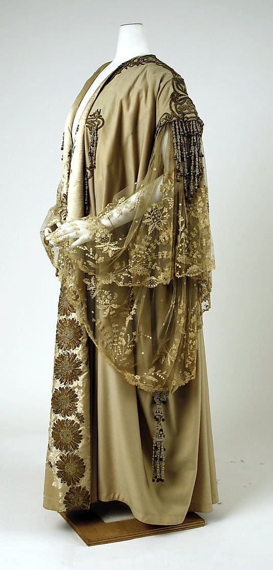House of Worth, evening wrap, French, late 19th - early 20th Century. Wool with metallic thread embroidery, floral-patterned lace, chiffon, tulle, beads, and rhinestones. Side view. MMA Collections.