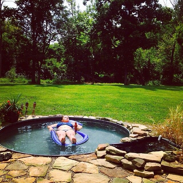 You Ll Start Seeing Stock Tank Pools Around This Summer Because They Set Up Easily For Less Than Stock Tank Pool Diy Diy Stock Tank Stock Tank Swimming Pool