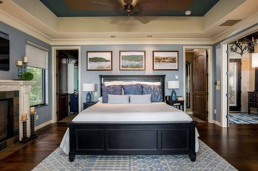 Walk through master closet behind bed in master bedroom