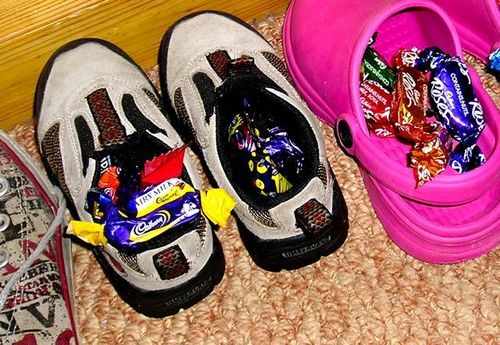 St. Nicholas leaves sweets in shoes.