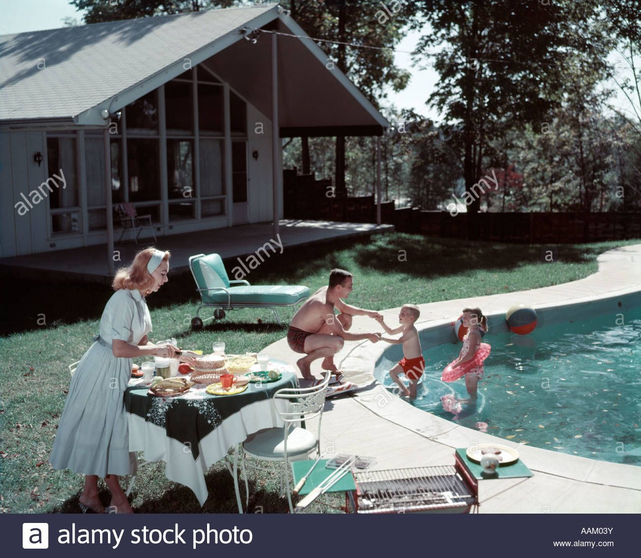 1950s Family Of 4 Backyard Swimming Pool House Mom Serving Food Meal Stock Photo Royalty Free Image 12 Swimming Pool House Swimming Pools Backyard Pool House