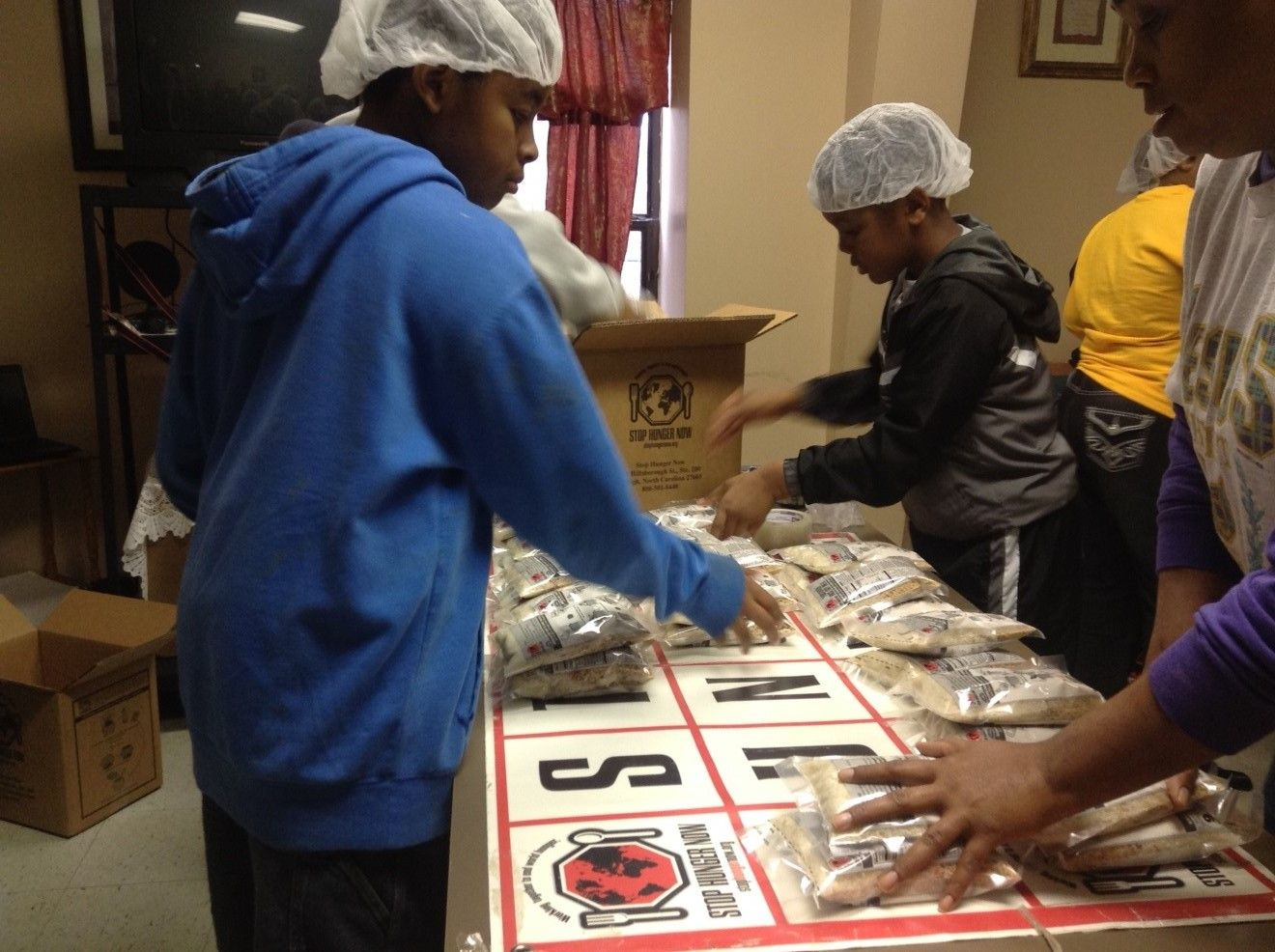 NGUMC Suwanee Parish UMC Packs 10,000 Meals For Stop