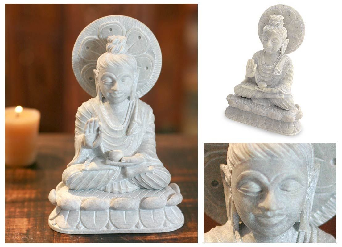 """Blessing Buddha : Natural Soapstone Sculpture   Meditating serenely on a lotus throne.A floral chakra wheel surrounds the master's head like a halo.. Buddha is a beautiful presence.   Product Code : DF-02  Size: 6.75"""" H x 4.7"""" W x 2.8"""" D  Weight: 2.2 lbs"""